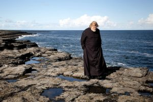 calvary-2013-006-father-james-alone-on-coastal-rocks