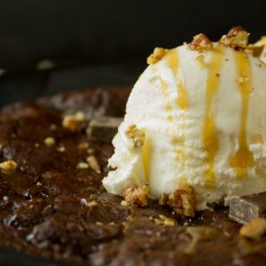 Double Chocolate Skillet Cookie with Pecans and Salted Caramel