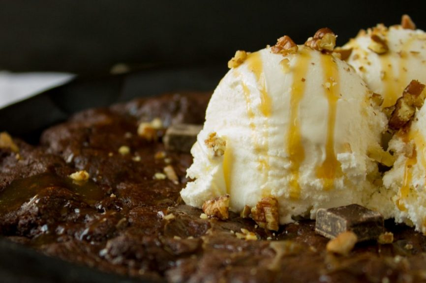 This ooey-gooey Double Chocolate Skillet Cookie with Pecans and Salted Caramel is simply out of this world!