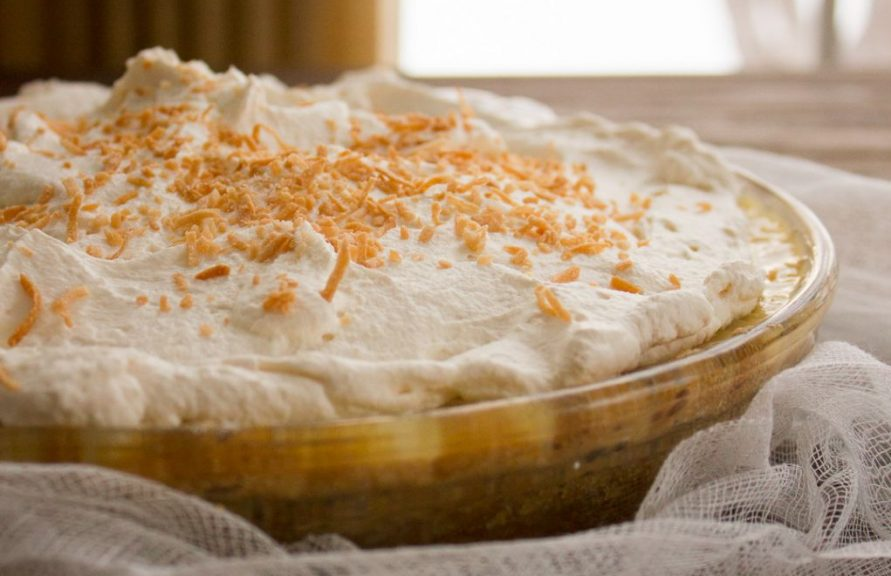 This Coconut Cream Pie with is a twist on a classic. Hearty coconut cream filling topped with whipped cream and toasted coconut, all on top of an oatmeal cookie crust for a little added crunch!