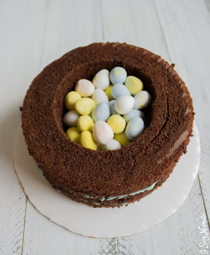 This beautiful Cookies and Cream Cake has a secret spring surprise inside! Made with rich chocolate cake and vanilla buttercream, crushed Oreos add the beautiful effect to this spring speckled egg cake.