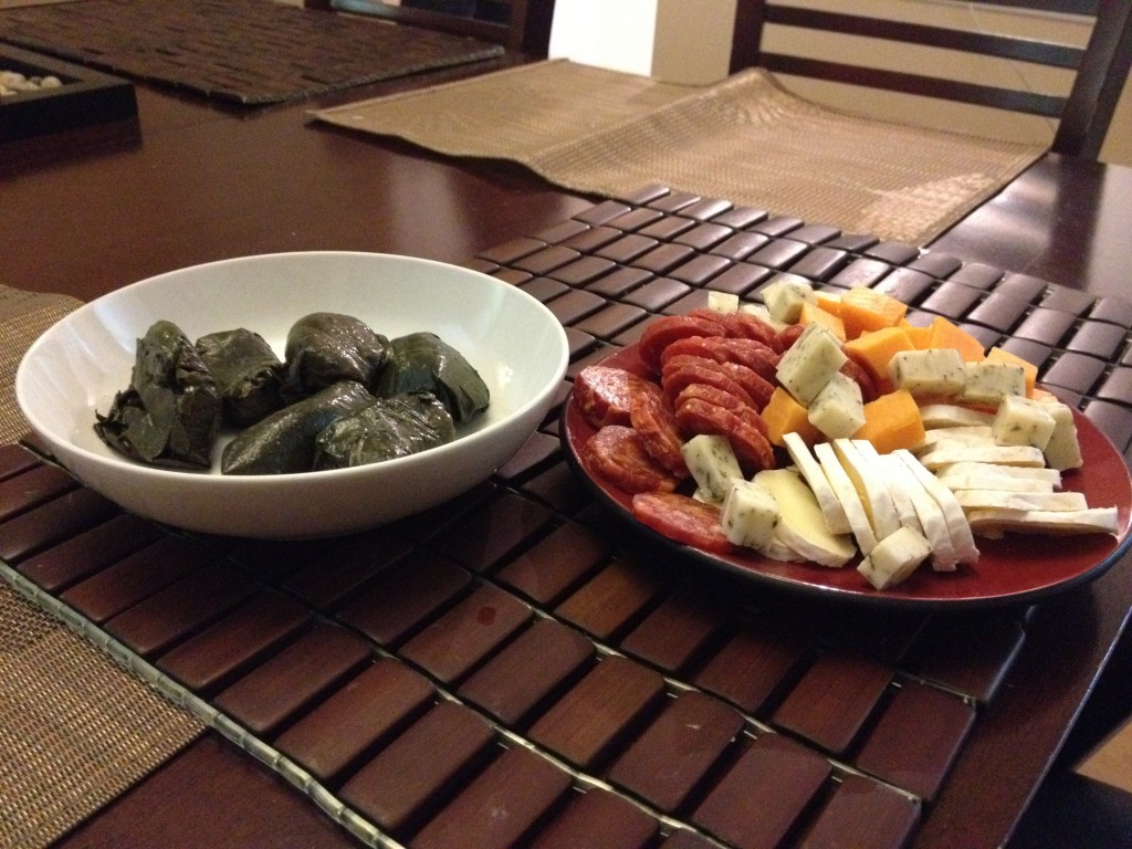 Appetizers grapeleaves pepperoni cheese brie