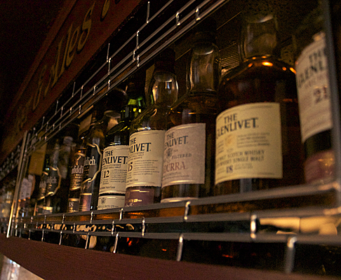 Large selection of whiskeys line the shelves at Lunar Rogues