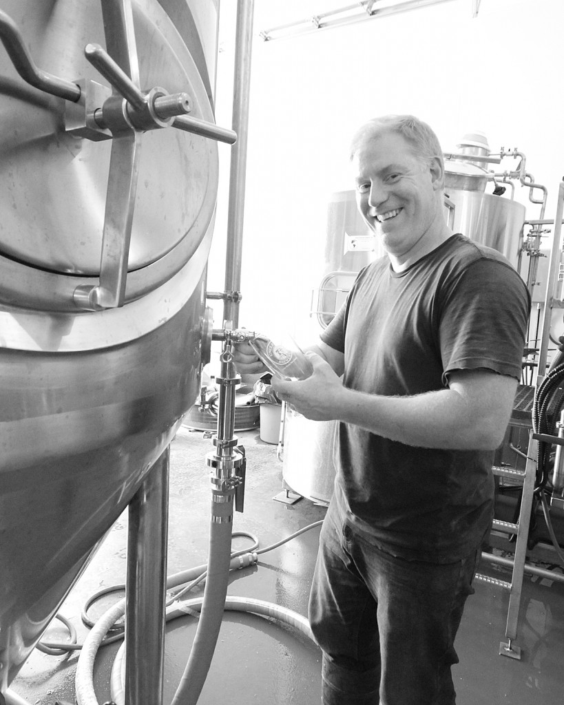 Karl Whiffen, Brewer at Uncle Leo's pouring the inaugural Beer